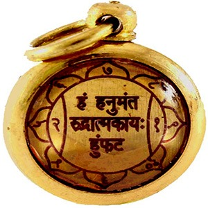 The Hanuman Yantra talisman worn as a locket for strength and protection