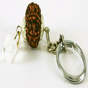 A rudraksh bead attached to a keychain