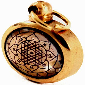 The Shri Yantra talisman in the form of a locket on a white background